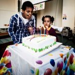 Family Centre - Blowing out candles.